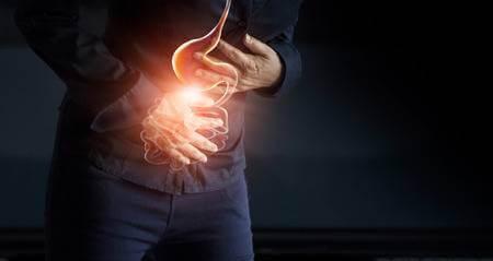 Болезни ЖКТ причина боли в середине спины