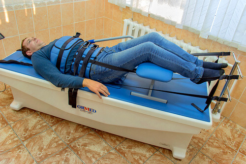 что делать при защемлении нерва в спине в пояснице - тракция вытяжение